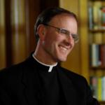 Portrait of Fr. Timothy Gallagher Smiling