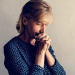Woman praying a Novena